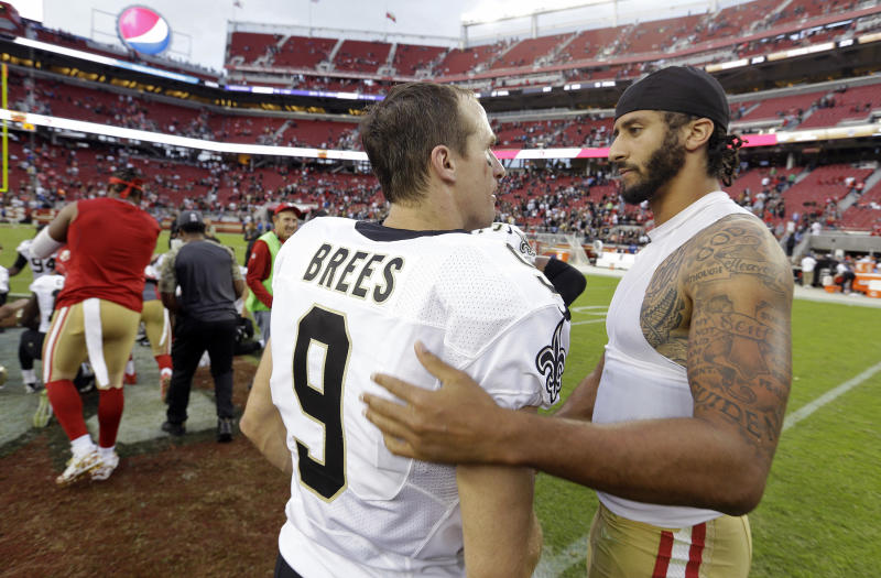 FILE - In this Nov. 6, 2016, file photo, San Francisco 49ers quarterback Colin Kaepernick, right, is greeted by New Orleans Saints quarterback Drew Brees at the end of an NFL football game in Santa Clara, Calif. As athletes and sports organizations around the world speak out against racial injustice in the wake of George Floyds death, Drew Brees drew sharp criticism after he reiterated his opposition to Colin Kaepernicks kneeling during the national anthem in 2016. (AP Photo/D. Ross Cameron, File)