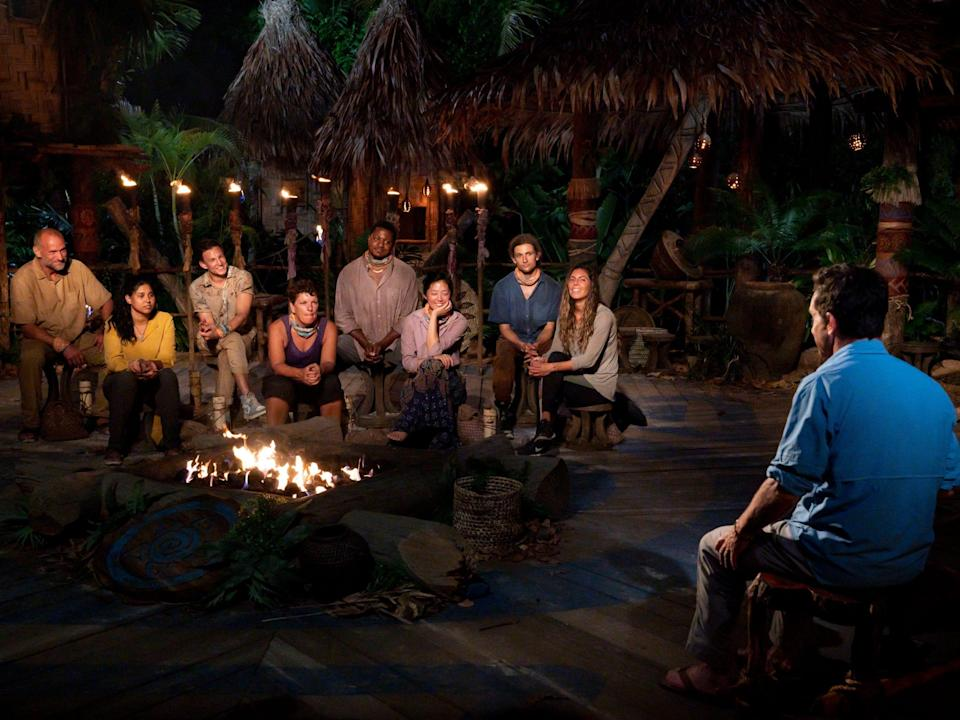 """The cast of """"Survivor: Island of the Idols"""" at tribal council with Jeff Probst"""
