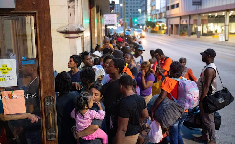 SAN ANTONIO, Texas – Delmy López, 31, from Honduras, holds her 2-year-old daughter, Perla, as they wait in line to enter the overnight shelter for migrants at the Travis Park United Methodist Church on June 27, 2019.