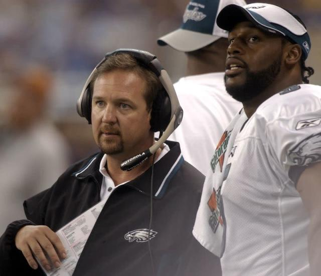 Eagles assistant coach Mornhinweg and quarterback McNabb during game against Lions.