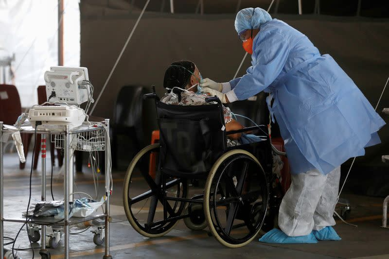 FILE PHOTO: A healthcare worker tends to a coronavirus patient at Steve Biko Academic Hospital in Pretoria