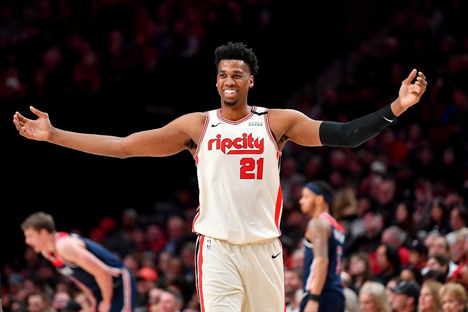PORTLAND, OREGON - MARCH 04: Hassan Whiteside #21 of the Portland Trail Blazers is all smiles during the fourth quarter of the game against the Washington Wizards at the Moda Center on March 04, 2020 in Portland, Oregon. The Portland Trail Blazers topped the Washington Wizards, 125-105. (Photo by Alika Jenner/Getty Images)