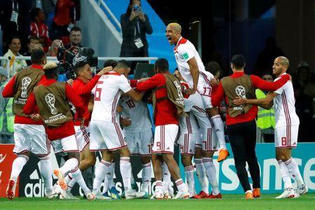 Soccer Football - World Cup - Group B - Spain vs Morocco - Kaliningrad Stadium, Kaliningrad, Russia - June 25, 2018 Morocco's Khalid Boutaib celebrates with team mates after scoring their first goal REUTERS/Fabrizio Bensch