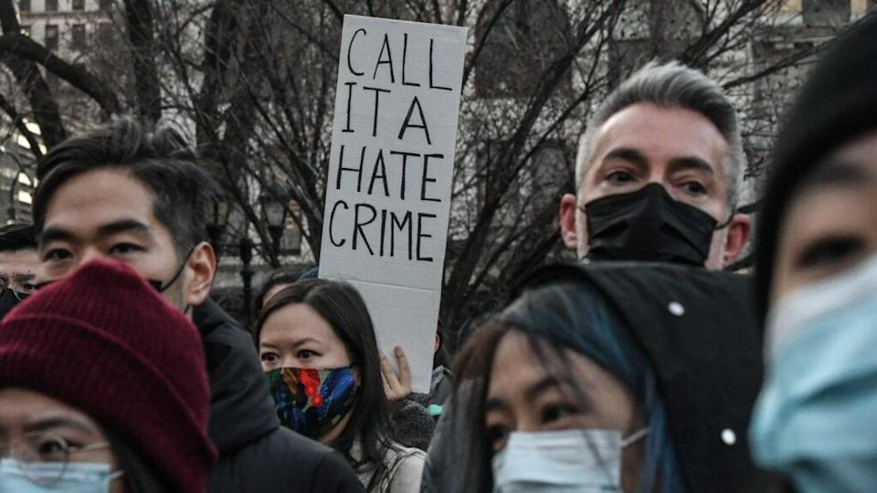 People participate in a recent peace vigil to honor victims of attacks on Asians in Union Square Park in New York City. (Photo by Stephanie Keith/Getty Images)