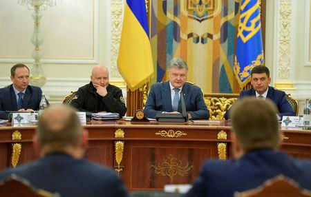 Ukrainian President Petro Poroshenko (2nd R) chairs a meeting with members of the National Security and Defence Council in Kiev, Ukraine December 26, 2018. Mykola Lazarenko/Ukrainian Presidential Press Service/Handout via REUTERS
