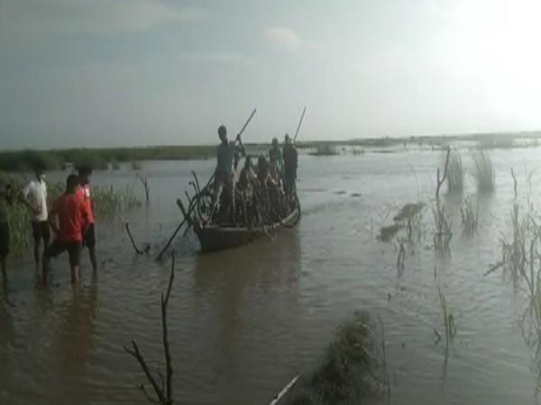 People being rescued after their boat got stuck in Gandak river, in Kushinagar on Friday. [Photo/ANI]