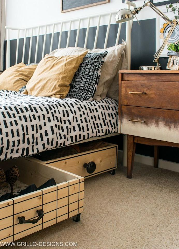 """<p>For a finished look, dress up standard wooden crates with knobs and metal accents that match your bedroom's aesthetic. An added bonus: These rolling boxes double as decor. </p><p><em><a href=""""https://grillo-designs.com/diy-under-bed-storage-boxes-with-modern-knobs/"""" target=""""_blank"""">See more at Grillo Designs »</a></em></p><p><strong>RELATED: </strong><a href=""""https://www.goodhousekeeping.com/home/organizing/g2818/bedroom-storage-hacks/"""" target=""""_blank"""">Smart Bedroom Storage Ideas to DIY </a></p>"""