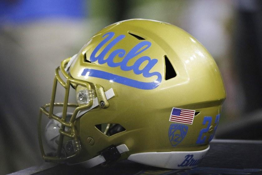 A UCLA helmet sits on the sideline during the second half of an NCAA college football game between Washington State and UCLA in Pullman, Wash., Saturday, Sept. 21, 2019. (AP Photo/Young Kwak)