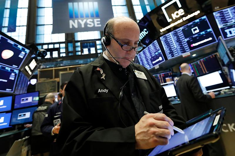 Trader Andrew Silverman works on the floor of the New York Stock Exchange, Tuesday, March 12, 2019. Another slide in Boeing weighed on the Dow Jones Industrial Average. (AP Photo/Richard Drew)
