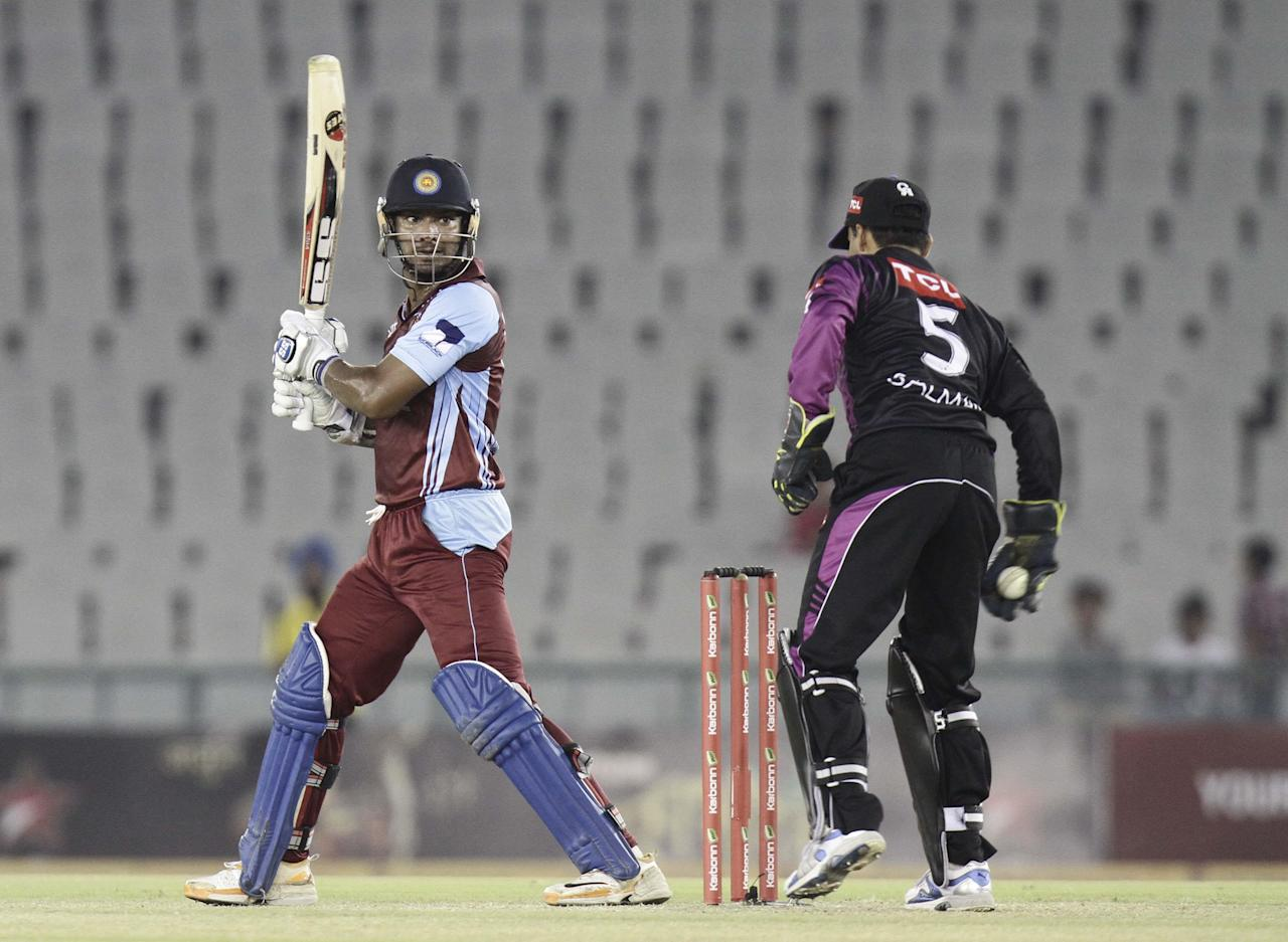 KC Sangakkara in action during the Champions League T20, 5th match between Faisalabad Wolves and Kandurata Maroons at Mohali stadium, Chandigarh on Sept. 20, 2013. (Photo: IANS)