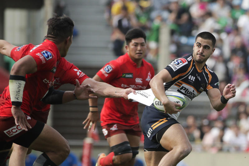 Sunwolves' Mark Abbott, left, grabs the jersey of Brumbies' Tom Wright during the second half of a Super Rugby game Saturday, June 1, 2019, in Tokyo. (AP Photo/Jae C. Hong)