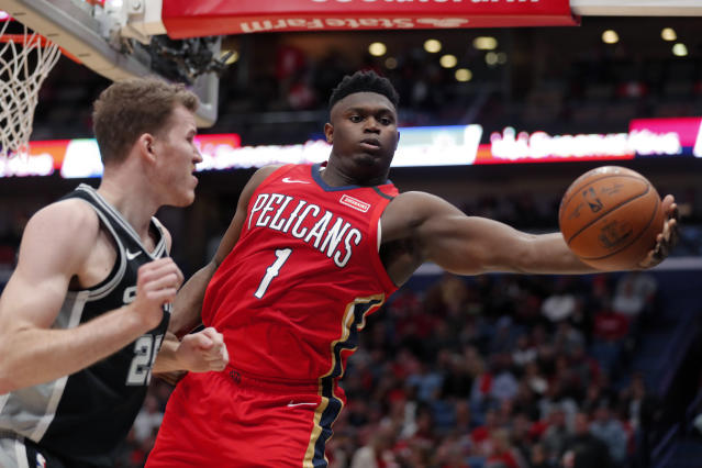 New Orleans Pelicans forward Zion Williamson (1) pulls in a rebound against San Antonio Spurs center Jakob Poeltl (25) in the second half of an NBA basketball game in New Orleans, Wednesday, Jan. 22, 2020. The Spurs won 121-117. (AP Photo/Gerald Herbert)