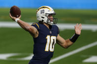 Los Angeles Chargers quarterback Justin Herbert throws a pass during the first half of an NFL football game against the Las Vegas Raiders, Sunday, Nov. 8, 2020, in Inglewood, Calif. (AP Photo/Ashley Landis)