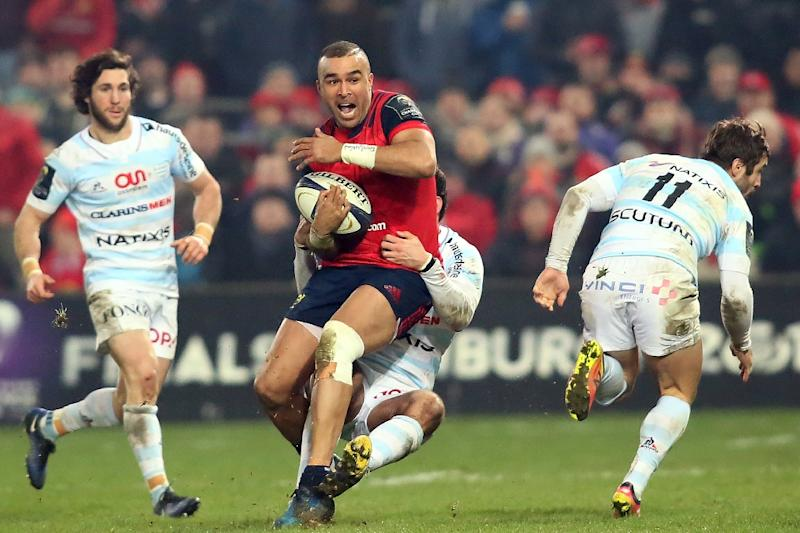 Munster's full-back Simon Zebo (C) is tackled during their European Rugby Champions Cup pool 1 match against Racing 92, at Thomond Park in Limerick, Ireland, on January 21, 2017 (AFP Photo/Paul Faith)