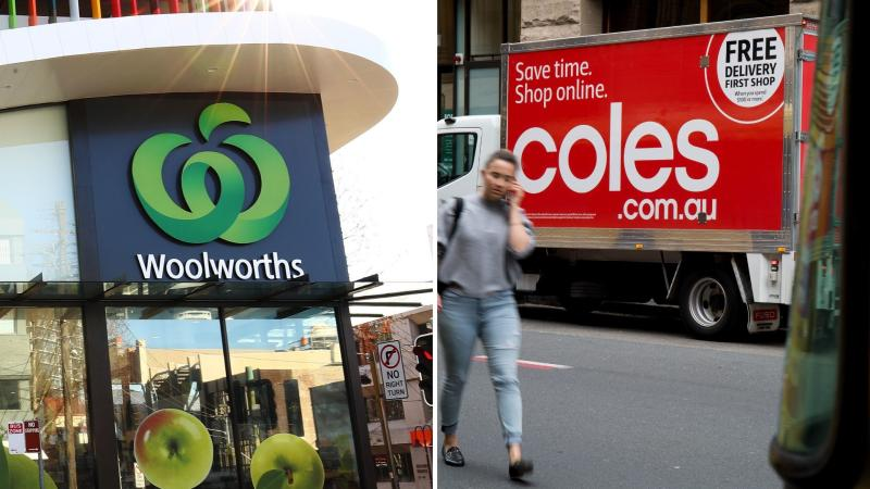 A Woolworths sign on the left and a Coles truck on the right.
