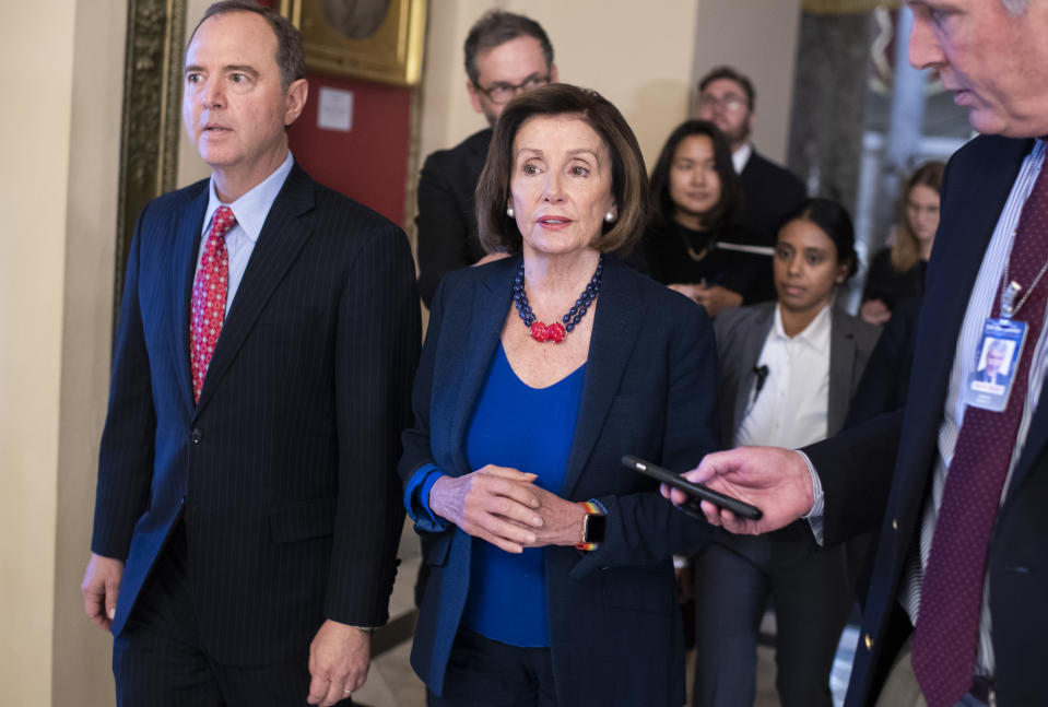 UNITED STATES - OCTOBER 18: Speaker of the House Nancy Pelosi, D-Calif., and House Intelligence Chairman Adam Schiff, D-Calif., make their way to the floor for the last House votes of the week on Friday, October 18, 2019. (Photo By Tom Williams/CQ-Roll Call, Inc via Getty Images)