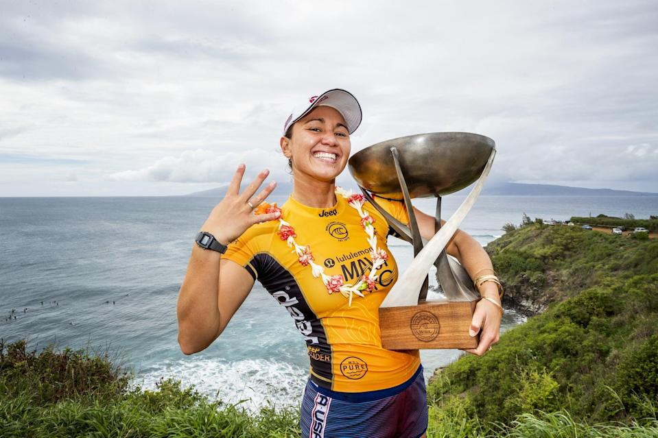 """<p><strong>Sport:</strong> Surfing<br> <strong>Country:</strong> USA</p> <p>Moore has captured four world titles in her decorated career, the most recent coming in December 2019 after a heated <a href=""""https://www.popsugar.com/fitness/surfers-carissa-moore-caroline-marks-make-us-olympic-team-46965372"""" class=""""link rapid-noclick-resp"""" rel=""""nofollow noopener"""" target=""""_blank"""" data-ylk=""""slk:three-way race with fellow Americans Caroline Marks and Lakey Peterson"""">three-way race with fellow Americans Caroline Marks and Lakey Peterson</a>. She's heading to the Olympics as the top seed (<a href=""""https://www.popsugar.com/fitness/who-is-caroline-marks-surfer-46978282"""" class=""""link rapid-noclick-resp"""" rel=""""nofollow noopener"""" target=""""_blank"""" data-ylk=""""slk:accompanied by Marks"""">accompanied by Marks</a>, who's ranked just below her at No. 2 in the world) and coming off of a <a href=""""https://www.worldsurfleague.com/athletes/tour/wct?year=2019"""" class=""""link rapid-noclick-resp"""" rel=""""nofollow noopener"""" target=""""_blank"""" data-ylk=""""slk:stellar season"""">stellar season</a>; out of 10 competitions, Moore was off the podium just twice and was never below the top five. She'd planned to take 2020 off from the pro tour to prepare for the Olympics, so the season's cancellation didn't affect her plans to a huge degree, and she's <a href=""""https://www.popsugar.com/fitness/olympic-bound-surfer-carissa-moore-on-staying-grateful-47457720"""" class=""""link rapid-noclick-resp"""" rel=""""nofollow noopener"""" target=""""_blank"""" data-ylk=""""slk:using the time to surf and train"""">using the time to surf and train</a> in her native Honolulu. Surfing is expected to make a big splash at the Olympics and Moore is a favorite with momentum on her side.</p>"""