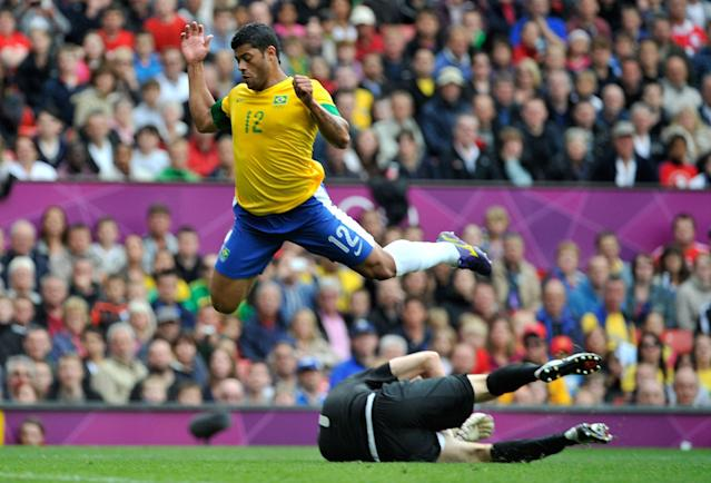 MANCHESTER, UNITED KINGDOM - JULY 29: Hulk of Brazil leaps over Alexandr Gutor of Belarus during the Men's Football first round Group C Match between Brazil and Belarus on Day 2 of the London 2012 Olympic Games at Old Trafford on July 29, 2012 in Manchester, England. (Photo by Francis Bompard/Getty Images)