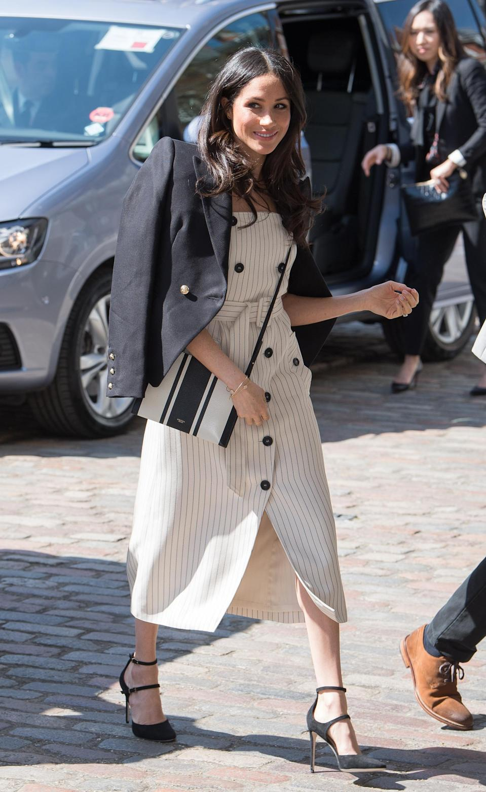 <p>In April Meghan was pictured wearing this cross body bag.<br>Source: Getty </p>