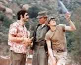"<p>Robert Altman's dark comedy, <em>M*A*S*H,</em> is based on a novel by Richard Hooker called <em><a href=""https://www.amazon.com/Mash-Novel-About-Three-Doctors/dp/0688149553"" rel=""nofollow noopener"" target=""_blank"" data-ylk=""slk:MASH: A Novel About Three Army Doctors"" class=""link rapid-noclick-resp"">MASH: A Novel About Three Army Doctors</a>. </em>The film follows the antics of a medical unit during the Korean War and was one of the biggest movies of the year—spurring a hit TV series of the same name in 1972.</p>"