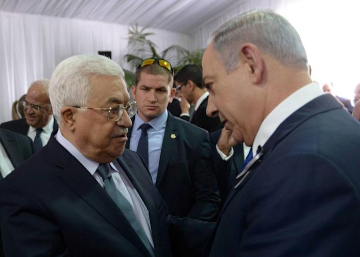 Image: Israeli PM Netanyahu shakes hands with Palestinian President Abbas during funeral of former Israeli President Shimon Peres in Jerusalem (Amos Ben Gershom/Government Press Office / Reuters file)