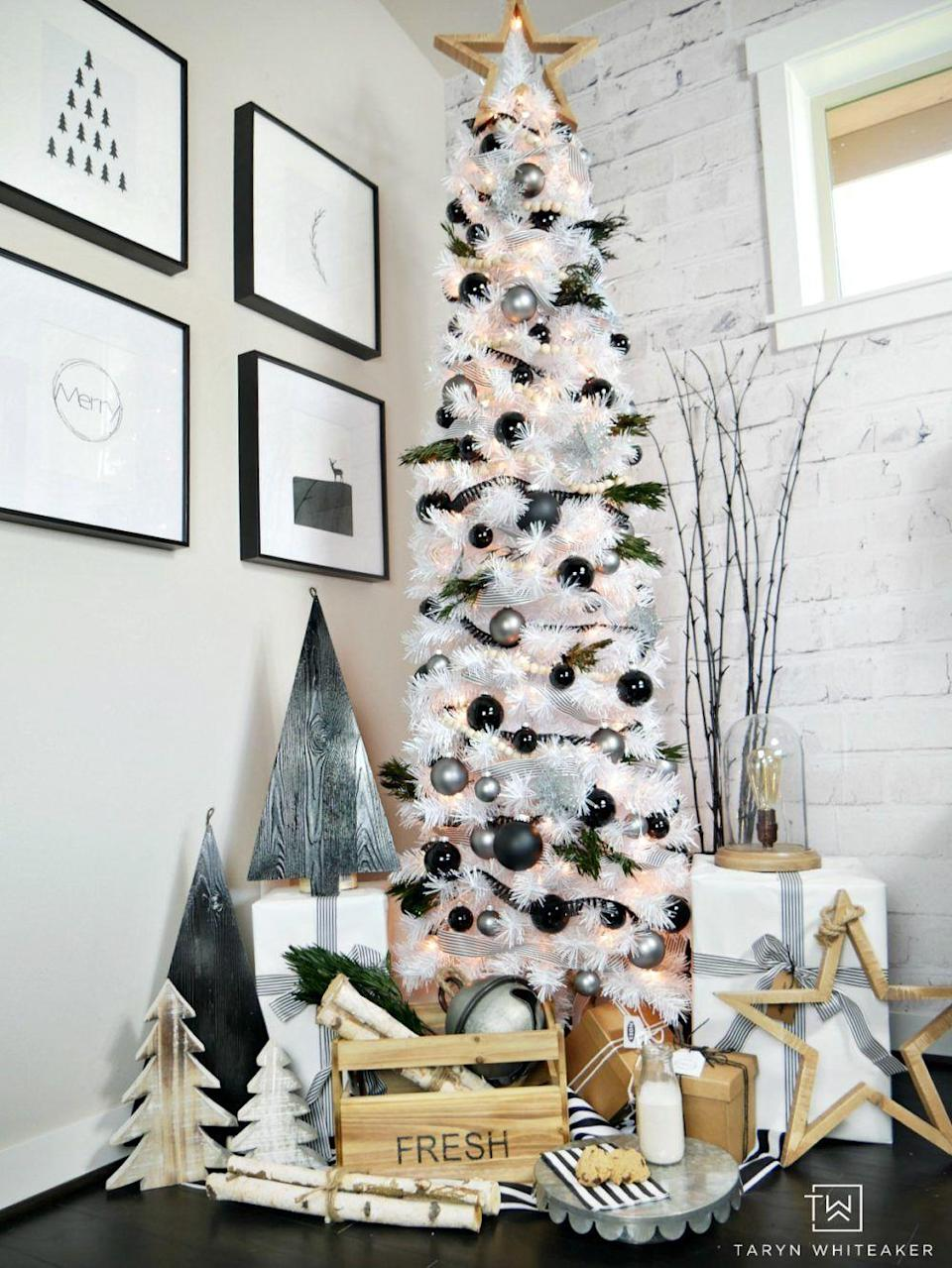 """<p>Full of clean black-and-white lines mixed with rustic touches, this tree couldn't be trendier. </p><p><strong><em>Get the tutorial at <a href=""""https://tarynwhiteaker.com/modern-black-white-christmas-tree/"""" rel=""""nofollow noopener"""" target=""""_blank"""" data-ylk=""""slk:Taryn Whiteaker Designs"""" class=""""link rapid-noclick-resp"""">Taryn Whiteaker Designs</a>. </em></strong></p><p><a class=""""link rapid-noclick-resp"""" href=""""https://www.amazon.com/Syhood-Garland-Farmhouse-Christmas-Decorations/dp/B08JJ7VKWR?tag=syn-yahoo-20&ascsubtag=%5Bartid%7C10070.g.2025%5Bsrc%7Cyahoo-us"""" rel=""""nofollow noopener"""" target=""""_blank"""" data-ylk=""""slk:SHOP WOOD BEAD GARLAND"""">SHOP WOOD BEAD GARLAND</a></p>"""