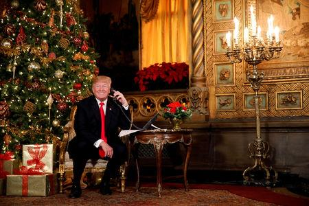 FILE PHOTO: U.S. President Donald Trump participates in NORAD (North American Aerospace Defense Command) Santa Tracker phone calls with children at Mar-a-Lago estate in Palm Beach, Florida