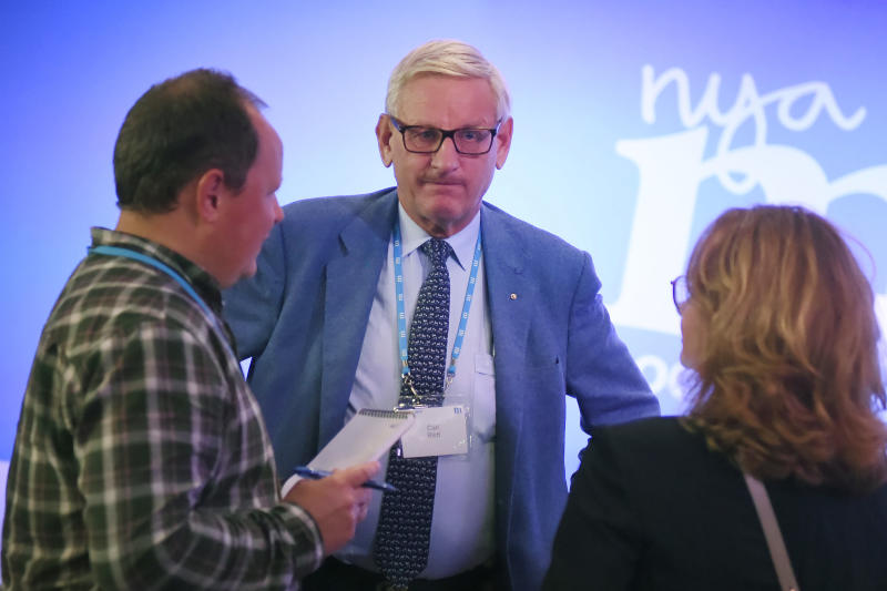Former Swedish Prime Minister Carl Bildt, center, attends the election party of the Moderate Party in Stockholm, Sweden, Sunday Sept. 9, 2018. Polls have opened in Sweden's general election in what is expected to be one of the most unpredictable and thrilling political races in Scandinavian country for decades amid heated discussion around top issue immigration. (Hanna Franzen/TT via AP)