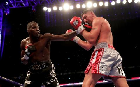 Lawrence Okolie punches Matty Askin during the British Cruiserweight Championship title fight between Matty Askin and Lawrence Okolie - Credit: Richard Heathcote/Getty Images