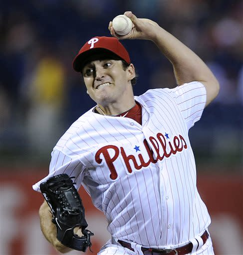 Philadelphia Phillies' John Lannan delivers a pitch in the first inning during the second game of a baseball doubleheader against the Chicago White Sox on Saturday, July 13, 2013, in Philadelphia. (AP Photo/Michael Perez)