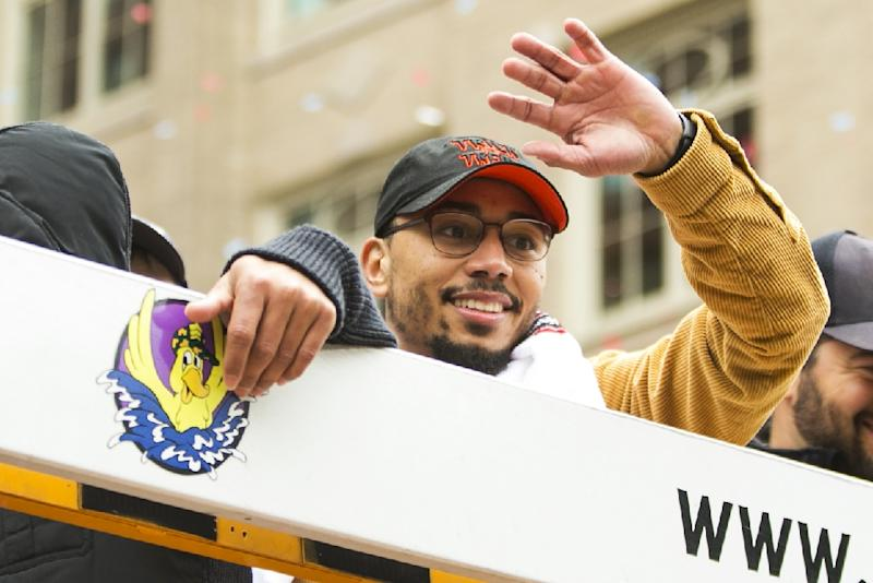 Boston star Mookie Betts, named the American League MVP, waves to fans during the Red Sox's World Series victory parade (AFP Photo/Adam Glanzman)