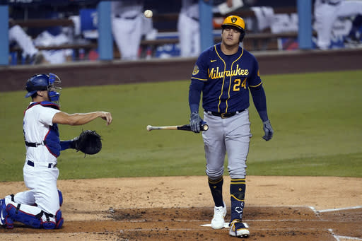 Milwaukee Brewers' Avisail Garcia reacts after striking out during the third inning in Game 2 of the team's National League wild-card baseball series against the Los Angeles Dodgers on Thursday, Oct. 1, 2020, in Los Angeles. (AP Photo/Ashley Landis)