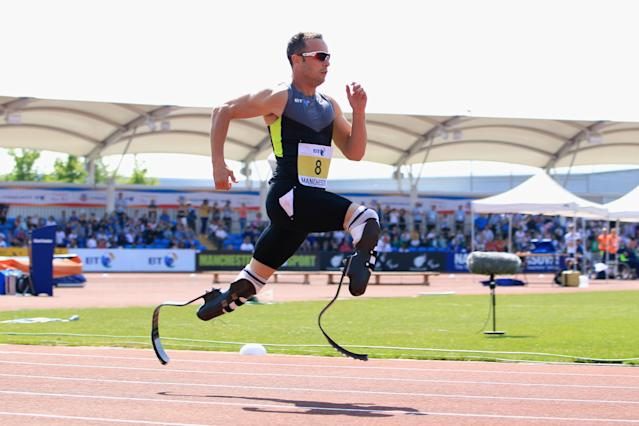 MANCHESTER, ENGLAND - MAY 22: Oscar Pistorius of South Africa on his way to victory in the men's T42/43/44 200m during day one of the BT Paralympic World Cup at Sportcity on May 22, 2012 in Manchester, England. (Photo by Michael Steele/Getty Images)
