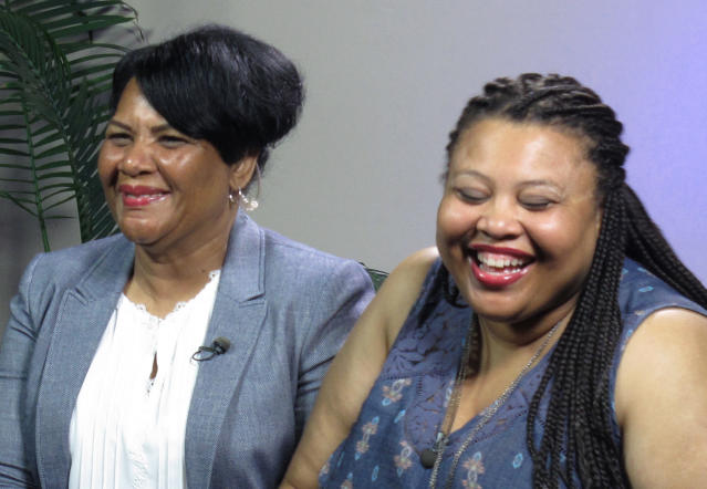Alice Marie Johnson (left), who was released from prison Wednesday, waits with her daughter, Katina Marie Scales, for a TV interview on Thursday. (Photo: Adrian Sainz/AP).