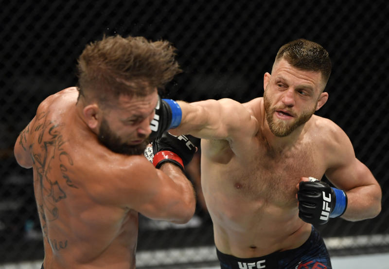 JACKSONVILLE, FLORIDA - MAY 09: (R-L) Calvin Kattar punches Jeremy Stephens in their featherweight fight during the UFC 249 event at VyStar Veterans Memorial Arena on May 09, 2020 in Jacksonville, Florida. (Photo by Jeff Bottari/Zuffa LLC)