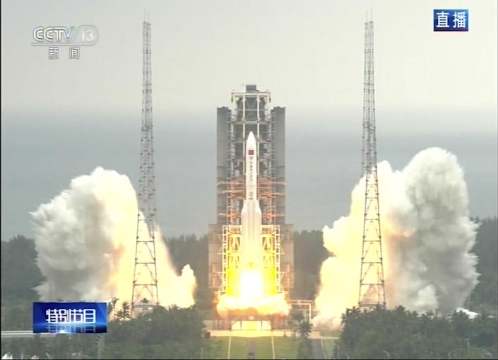 In this image taken from video footage run by China's CCTV via AP Video, a Long March 5B rocket carrying a module for a Chinese space station lifts off from the Wenchang Spacecraft Launch Site in Wenchang in southern China's Hainan Province, Thursday, April 29, 2021. China has launched the core module on Thursday for its first permanent space station that will host astronauts long-term. (CCTV via AP Video)