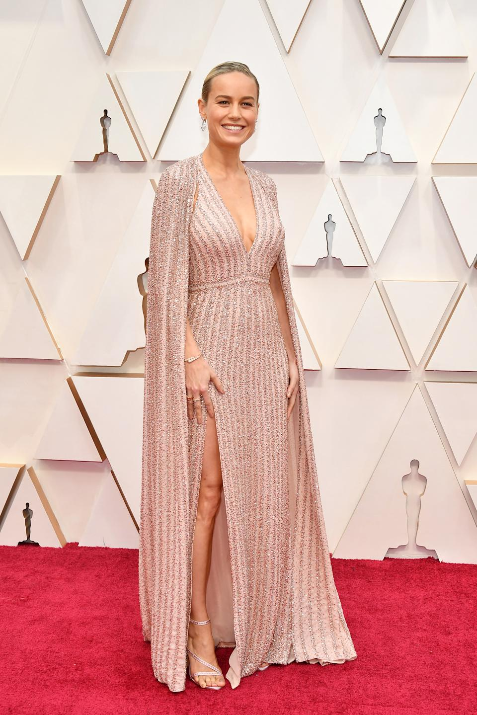 """The Oscar winner and """"Captain Marvel"""" star sparkled in a blush pink gown with a matching dramatic cape."""