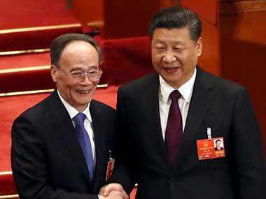 Chinese President Xi Jinping shakes hands with Wang Qishan after Wang was elected vice-president during a plenary session of China's National People's Congress in Beijing. AP
