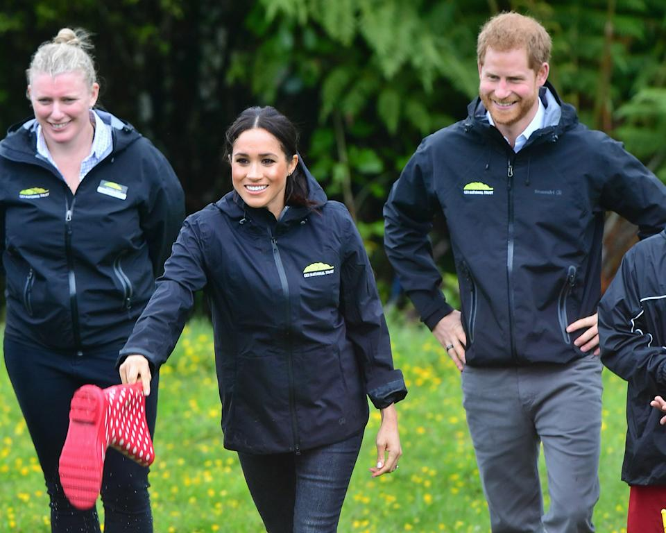 REDVALE, NEW ZEALAND - OCTOBER 30:  Prince Harry, Duke of Sussex and Meghan, Duchess of Sussex participate in a Wellie wanging contest while attending the Unveiling of The Queen's Commonwealth Canopy on October 30, 2018 in Redvale, New Zealand. The Duke and Duchess of Sussex are on their official 16-day Autumn tour visiting cities in Australia, Fiji, Tonga and New Zealand.  (Photo by Samir Hussein/Samir Hussein / WireImage)