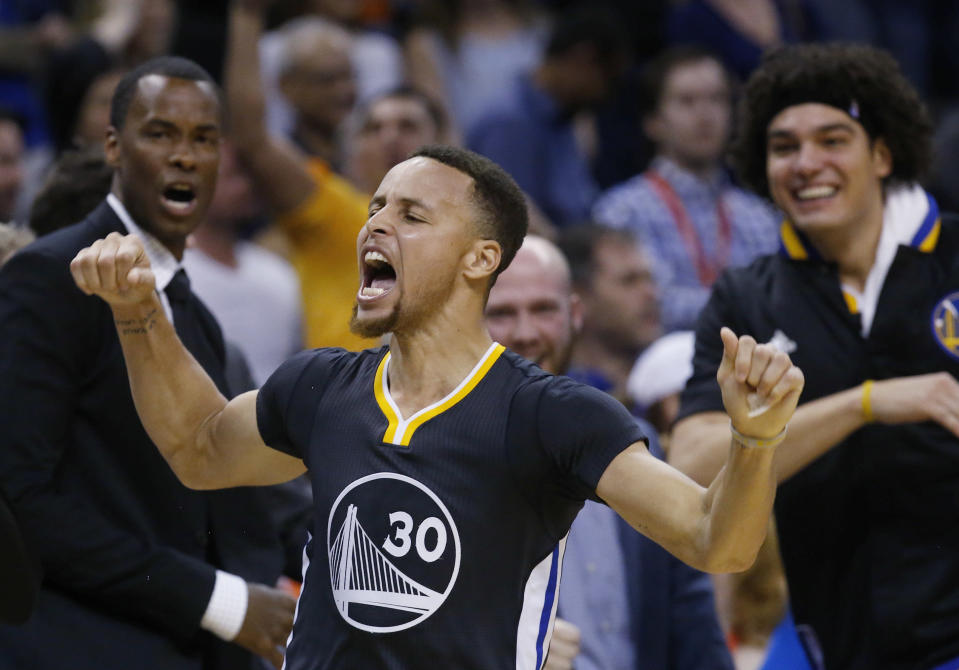 Warriors guard Stephen Curry celebrates after hitting a long-range game-winning 3 in overtime to beat the Thunder on Feb. 27, 2016. (AP Photo/Sue Ogrocki)