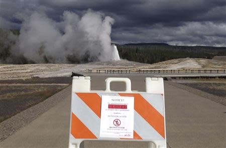 A sign announces the closure of the Old Faithful Geyser in Yellowstone National Park