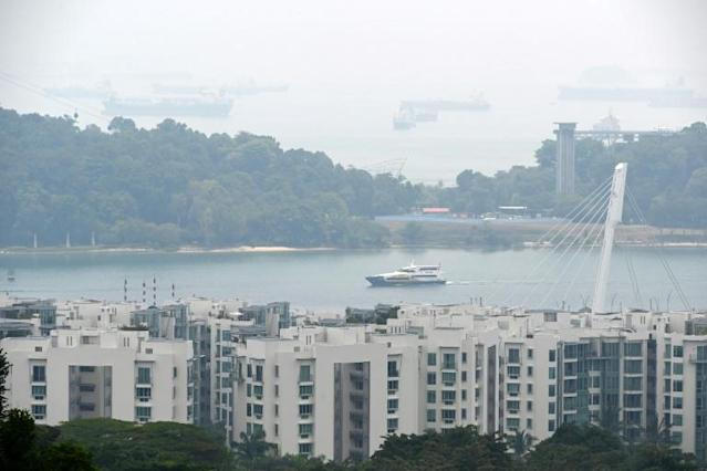 Singapore may continue to experience hazy conditions over the next few days, the environment agency warned (AFP Photo/Roslan RAHMAN)