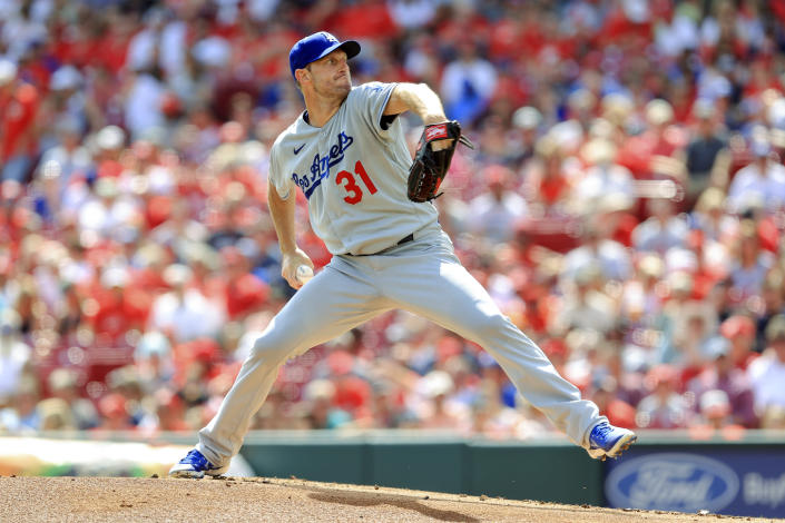 Los Angeles Dodgers' Max Scherzer throws during the first inning of a baseball game against the Cincinnati Reds in Cincinnati, Saturday, Sept. 18, 2021. (AP Photo/Aaron Doster)
