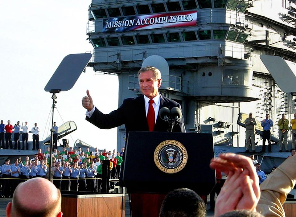 George W Bush declares 'mission accomplished' in Iraq aboard an aircraft carrier in 2003AP Photo/J. Scott Applewhite, File
