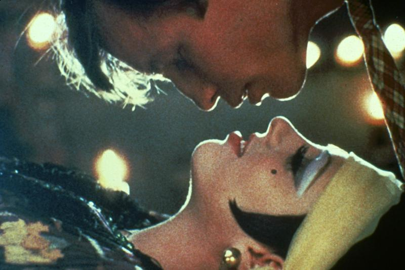 """This 1972 photo released by Warner Bros. Home Video shows Michael York as Brian Roberts, top, and Liza Minnelli as Sally Bowles in a scene from """"Cabaret."""" The landmark film """"Cabaret"""", starring Liza Minnelli, Joel Grey and Michael York, has turned 41. All three actors will be attending an anniversary celebration screening planned Thursday, Jan. 31, 2013, at the Ziegfeld Theatre, where the movie first premiered in 1972. (AP Photo/Warner Bros. Home Video)"""