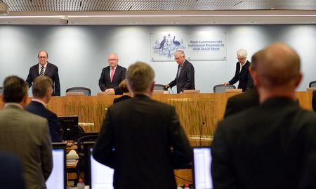 Officials from the Royal Commission into Institutional Responses to Child Sexual Abuse arrive on the opening day of their public hearing into the Anglican Church of Australia in Sydney, Australia, March, 17 2017. Royal Commission into Institutional Responses to Child Sexual Abuse/Jeremy Piper/Handout via REUTERS