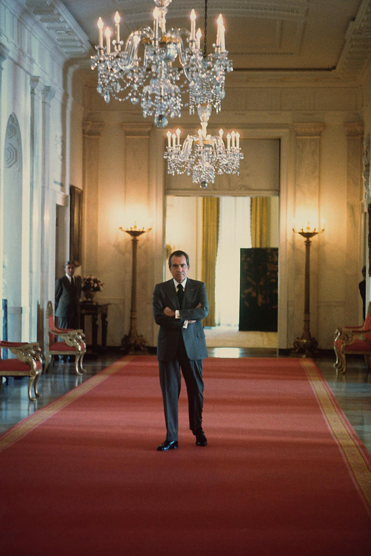 WASHINGTON - JANUARY 1974: (NO U.S. TABLOID SALES) U.S. President Richard Nixon waits in the hallway outside the East Room of the White House to give a press conference in January 1974 Washington, DC. (Photo by David Hume Kennerly/Getty Images)