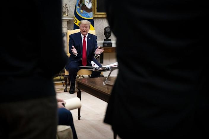 """President Trump speaks to reporters in the Oval Office on Thursday during a meeting with Texas Gov. Greg Abbott. <span class=""""copyright"""">(Doug Mills / Pool Photo)</span>"""