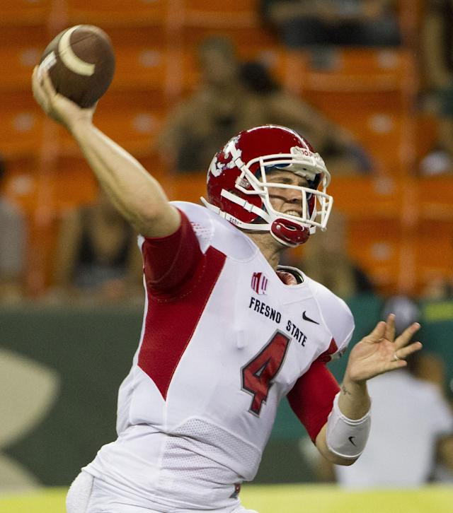 Fresno State quarterback Derek Carr (4) throws a pass in the third quarter of an NCAA college football game Saturday, Sept. 28, 2013, in Honolulu. (AP Photo/Eugene Tanner)