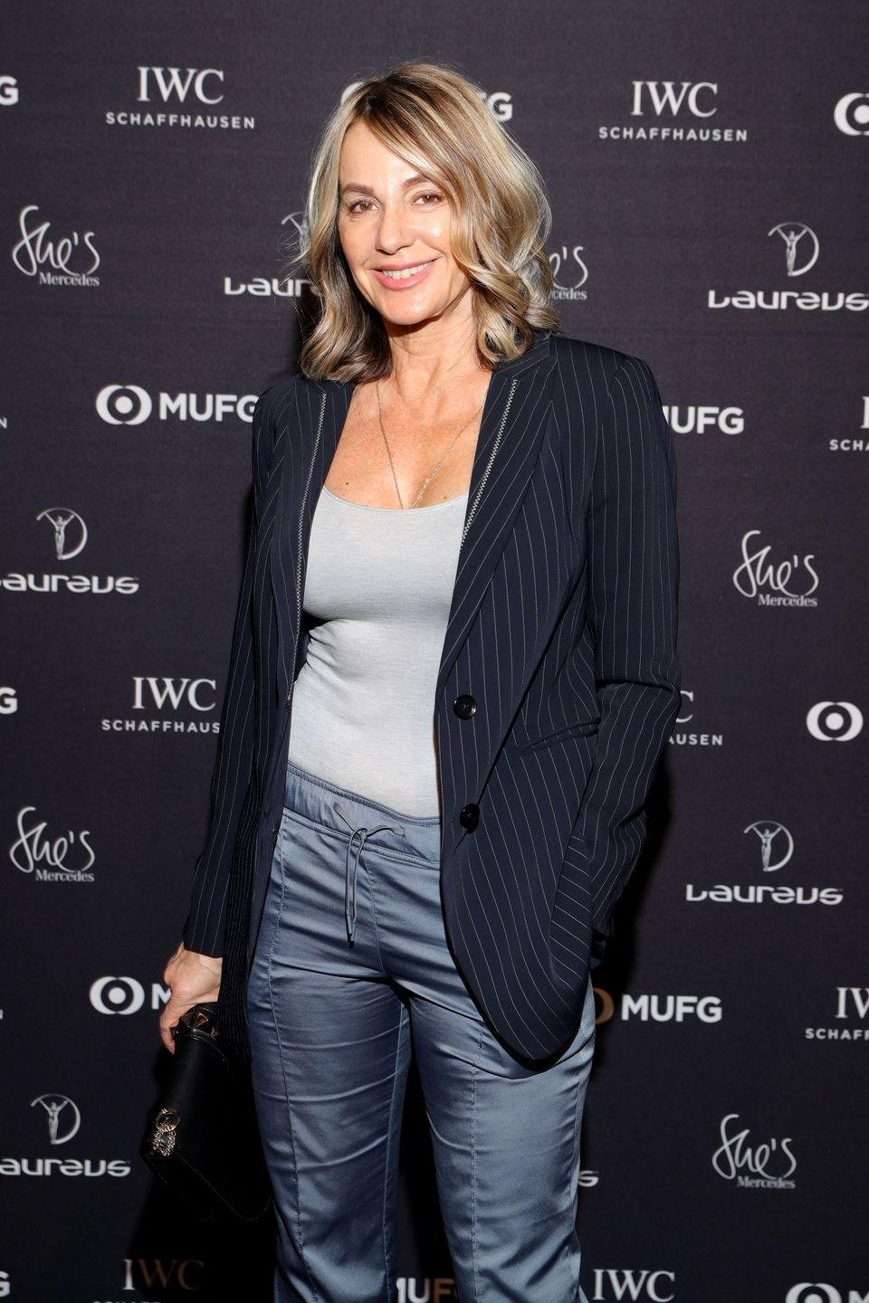 """<p>Throughout her gymnastics career, Comaneci would go on to win a total of <a href=""""https://www.britannica.com/biography/Nadia-Comaneci"""" rel=""""nofollow noopener"""" target=""""_blank"""" data-ylk=""""slk:five gold Olympic medals"""" class=""""link rapid-noclick-resp"""">five gold Olympic medals</a>. She retired from the sport in 1984 and became a United States citizen in 2001. She is married to former American gymnast Bart Connor and has authored several books. </p>"""